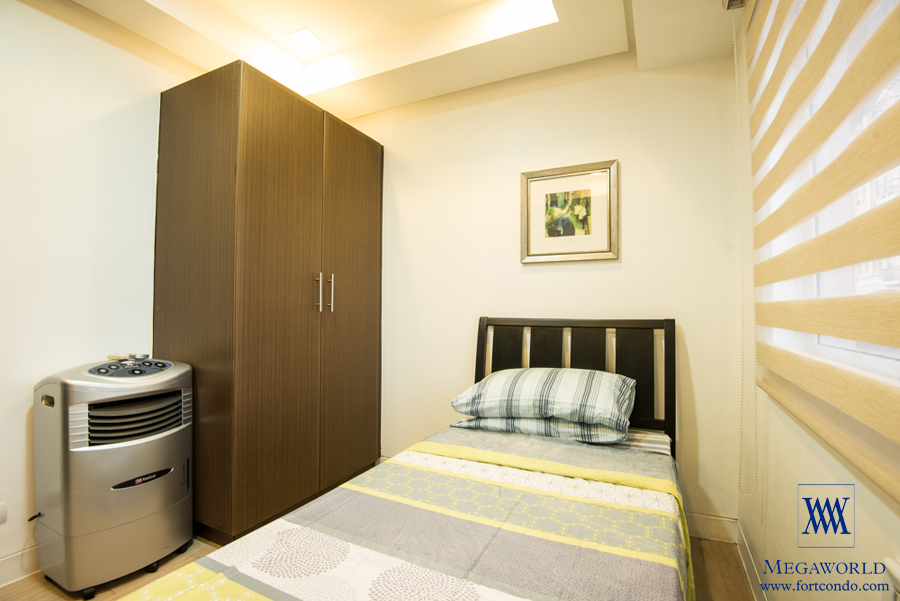 for rent two bedroom condo with balcony at mckinley hill tuscany fort